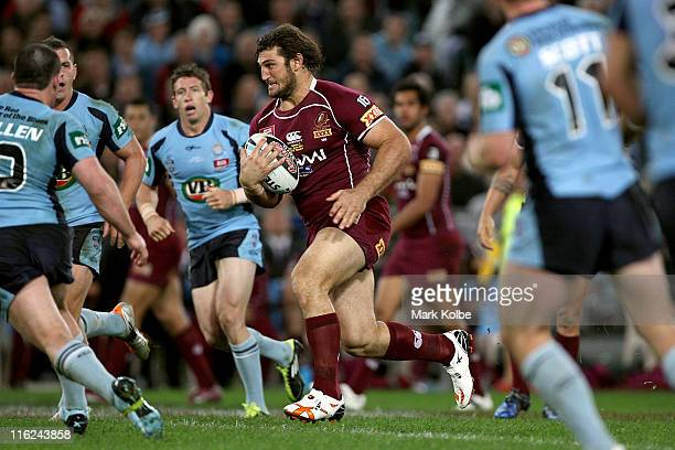 David Taylor of the Maroons makes a break during game two of the ARL State of Origin series between the New South Wales Blues and the Queensland...