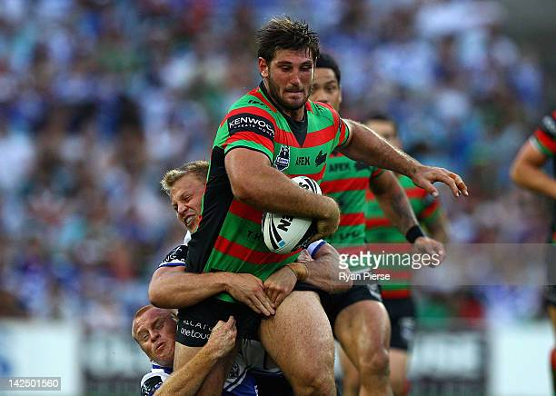 David Taylor of the Rabbitohs is tackled during the round six NRL match between the South Sydney Rabbitohs and the Canterbury Bulldogs at ANZ Stadium...