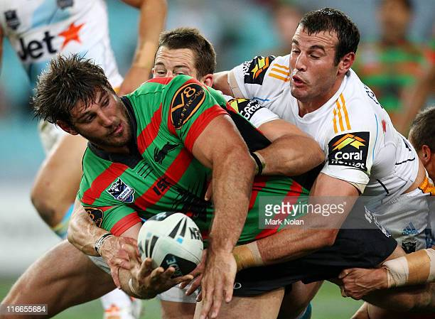David Taylor of the Rabbitohs offloads during the round 15 NRL match between the South Sydney Rabbitohs and the Gold Coast Titans at ANZ Stadium on...