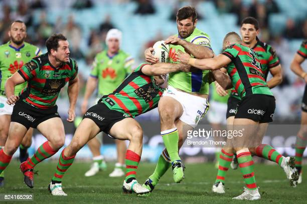 David Taylor of the Raiders is tackled by the Rabbitohs defence during the round 21 NRL match between the South Sydney Rabbitohs and the Canberra...