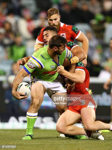 David Taylor of the Raiders looks to offload during the round 19 NRL match between the Canberra Raiders and the St George Illawarra Dragons at GIO...
