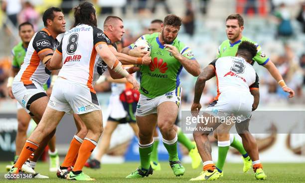 David Taylor of the Raiders runs the ball during the round three NRL match between the Canberra Raiders and the Wests Tigers at GIO Stadium on March...