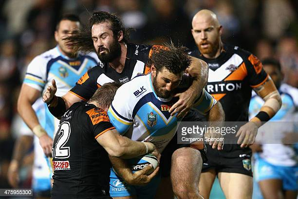 David Taylor of the Titans is tackled during the round 13 NRL match between the Wests Tigers and the Gold Coast Titans at Leichhardt Oval on June 5...