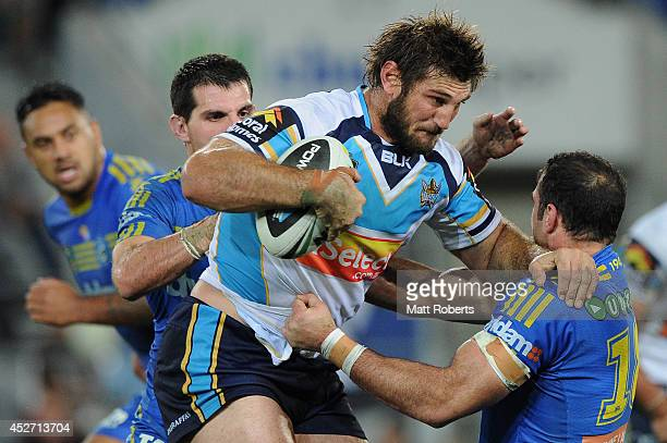David Taylor of the Titans is tackled during the round 20 NRL match between the Gold Coast Titans and the Parramatta Eels at Cbus Super Stadium on...