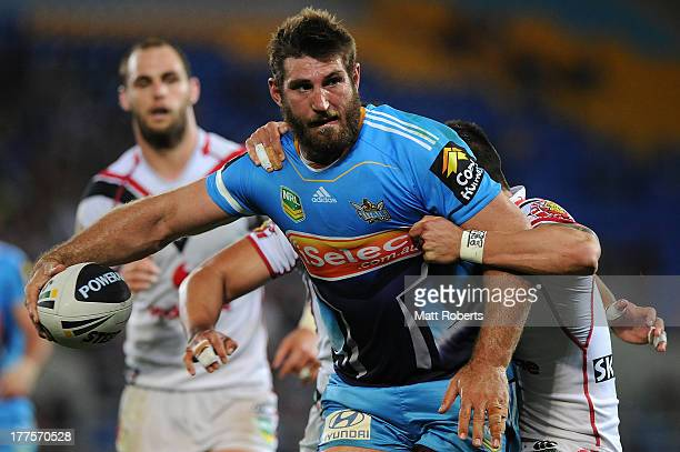 David Taylor of the Titans is tackled during the round 24 NRL match between the Gold Coast Titans and the New Zealand Warriors at Skilled Park on...
