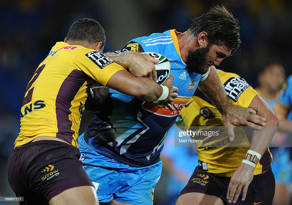 David Taylor of the Titans is tackled during the round five NRL match between the Gold Coast Titans and the Brisbane Broncos at Skilled Park on April 5, 2013 on the Gold Coast, Australia.