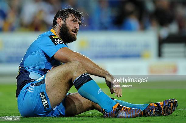 David Taylor of the Titans looks dejected after the round five NRL match between the Gold Coast Titans and the Brisbane Broncos at Skilled Park on...