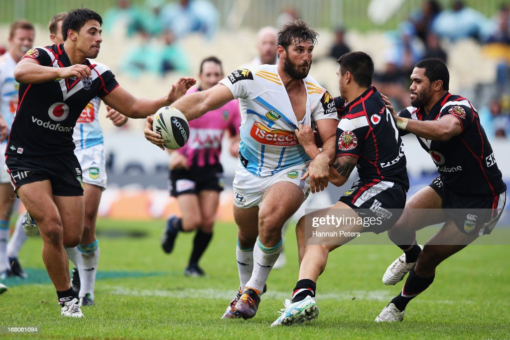 David Taylor of the Titans looks to offload the ball during the round eight NRL match between the New Zealand Warriors and the Gold Coast Titans at Mt Smart Stadium on May 5, 2013 in Auckland, New Zealand.