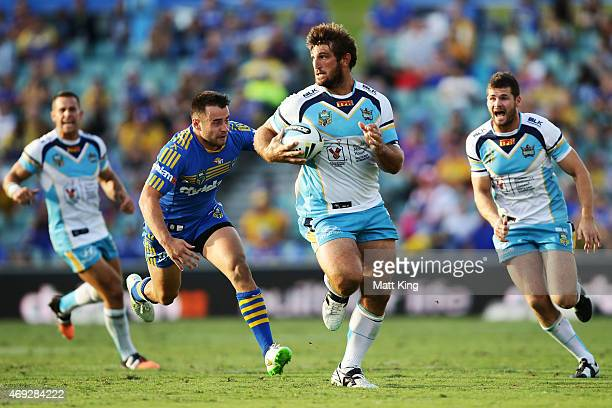 David Taylor of the Titans makes a break during the round six NRL match between the Parramatta Eels and the Gold Coast Titans at Pirtek Stadium on...