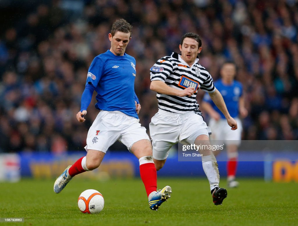 David Templeton of Rangers tussles with David Anderson of Queens Park during the IRN-BRU Scottish Third Division match between Queens Park and Rangers at Hampden Park on December 29, 2012 in Glasgow, Scotland.