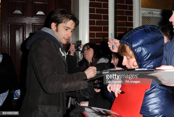 David Tennant signs autographs for waiting fans outside the stage door after his final performance as Hamlet at The Novello Theatre central London