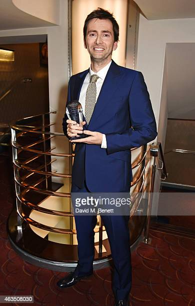 David Tennant winner of Best Actor in a Play for 'Richard II' poses in the press room at the WhatsOnStage Awards at The Prince of Wales Theatre on...