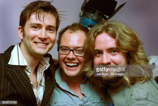 David Tennant with Justin Lee Collins and Alan Carr during a performance for the Friday Night Project at the CatPantomime Theatre in Catford south...