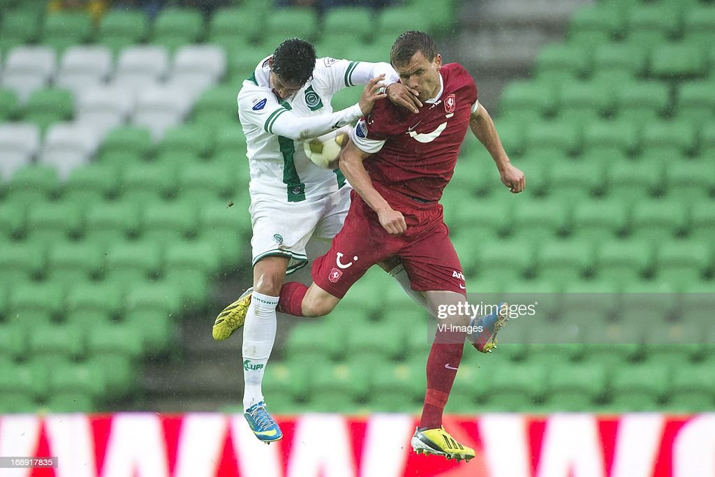 David Texeira of FC Groningen, Andreas Bjelland of FC Twente during the Eredivisie Europa League Playoff match between FC Groningen and FC Twente on May 16, 2013 at the Euroborg stadium at Groningen, The Netherlands.