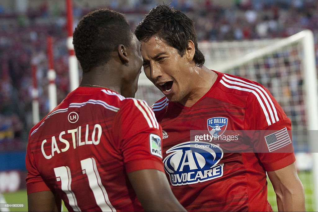 David Texeira #9 of the FC Dallas celebrates with teammate Fabian Castillo #11 after scoring a goal against the Seattle Sounders FC on April 12, 2014 at Toyota Stadium in Frisco, Texas.