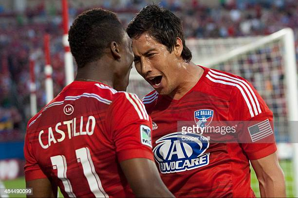 David Texeira of the FC Dallas celebrates with teammate Fabian Castillo after scoring a goal against the Seattle Sounders FC on April 12 2014 at...