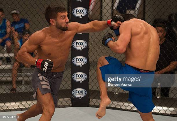David Teymur punches Johnny Nunez during the filming of The Ultimate Fighter Team McGregor vs Team Faber at the UFC TUF Gym on August 11 2015 in Las...