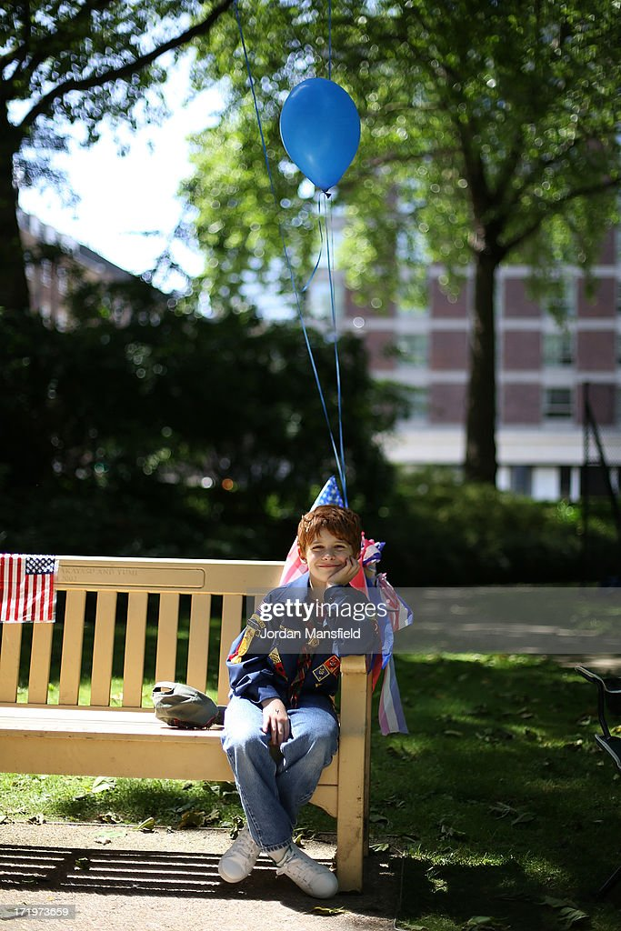 David Thieme, 10, sits on a bench with American flag bunting and balloons on June 30, 2013 in London, England. American Democrats living in London gather in Portman Square for the largest Independence Day celebration in London ahead of the American federal holiday on the 4th July which commemorates the Declaration of Independence on July 4, 1776 which declared them the USA free from the Kingdom of Great Britain.