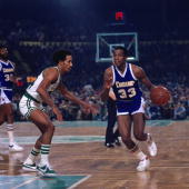 David Thompson of the Denver Nuggets moves the ball up court against Dave Bing of the Boston Celtics during a game played in 1975 at the Boston...