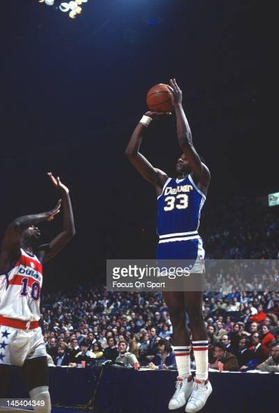 David Thompson of the Denver Nuggets shoots over Bob Dandridge of the Washington Bullets during an NBA basketball game circa 1977 at The Capital...
