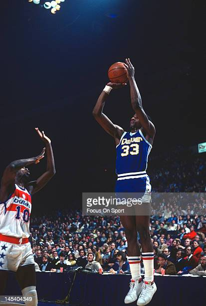 David Thompson of the Denver Nuggets shoots over Bob Dandridge of the Washington Bullets during an NBA basketball game circa 1977 at The Capital...