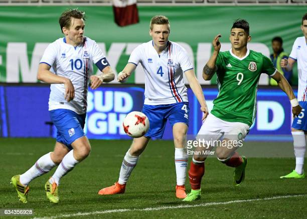 David Thor Vidarsson and Orri Sigurdur Omarsson of Iceland chase after the ball against Alan Pulido of Mexico during their exhibition match at Sam...