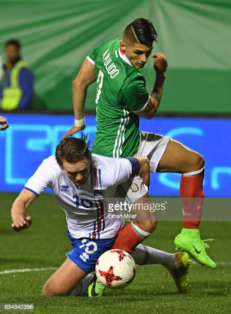 David Thor Vidarsson of Iceland tries to block a shot by Alan Pulido of Mexico during their exhibition match at Sam Boyd Stadium on February 8 2017...