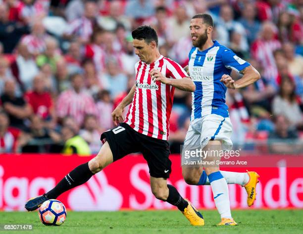 David Timor of Club Deportivo Leganes competes for the ball with Aritz Aduriz of Athletic Club during the La Liga match between Athletic Club Bilbao...