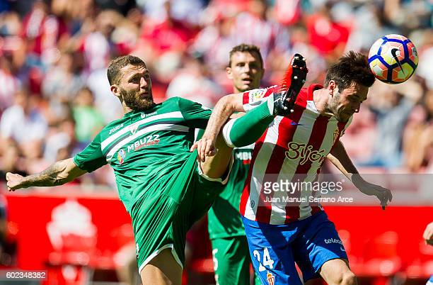 David Timor of Club Deportivo Leganes duels for the ball with Duje Cop of Real Sporting de Gijon during the La Liga match between Real Sporting de...