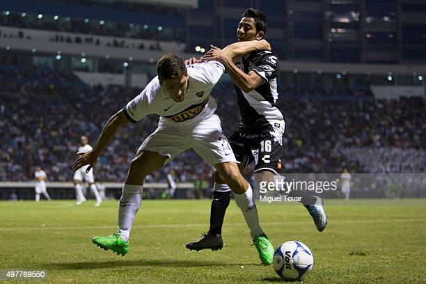 David Toledo of Puebla fights for the ball with Lisandro Magallan of Boca Juniors during the opening friendly match between Puebla and Boca Juniors...