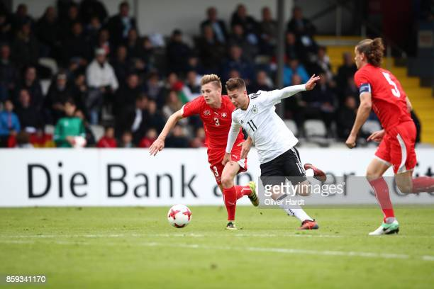David Tomic of Germany and Tobias Schaettin of Switzerland compete for the ball during the international friendly U20 match between U20 Germany and...