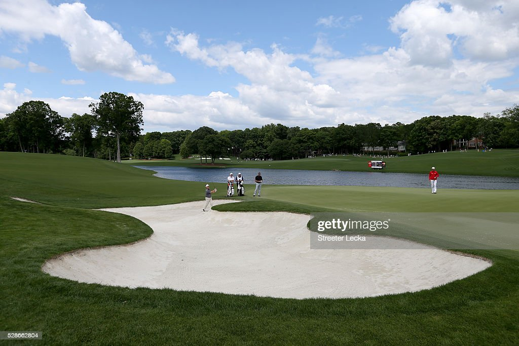 David Toms hits a shot from the sand on the 16th hole during the second round of the 2016 Wells Fargo Championship at Quail Hollow Club on May 6, 2016 in Charlotte, North Carolina.