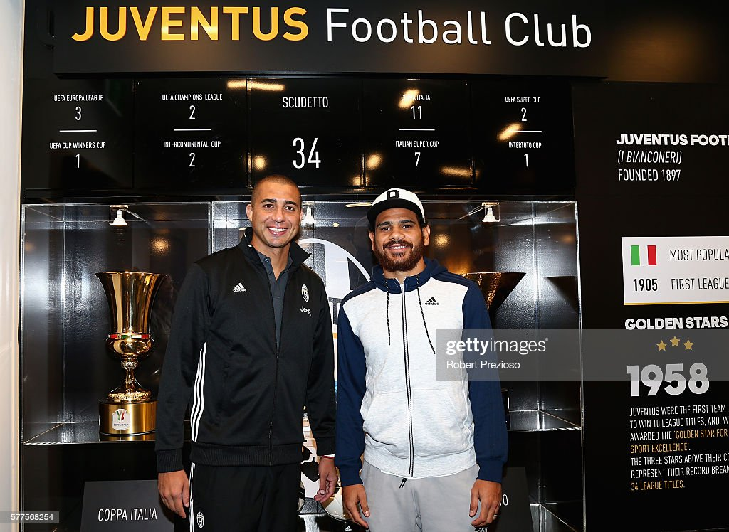David Trezeguet and Hawthorn fc player Cyril Rioli pose during a Juventus FC player visit to the Bourke Street adidas store on July 19 2016 in...