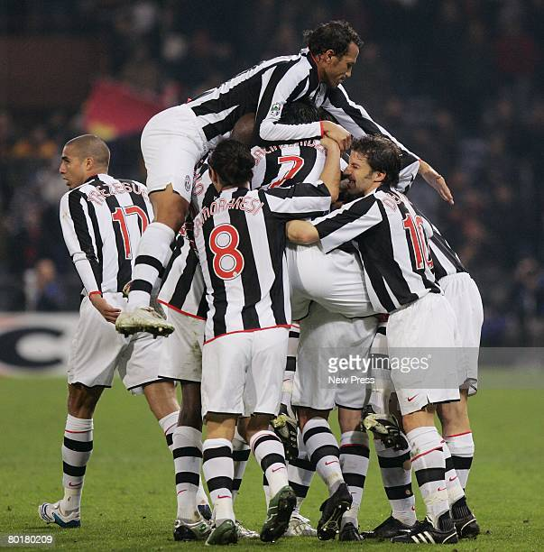 David Trezeguet is congratulated by his Juventus teammates after scoring the second goal during the Serie A match between Genoa and Juventus at the...