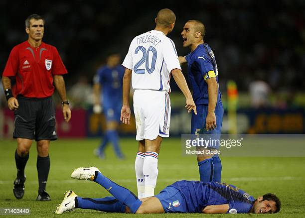 David Trezeguet of France and Fabio Cannavaro of Italy argue whilst Marco Materazzi of Italy lies injured after being headbutted in the chest by...