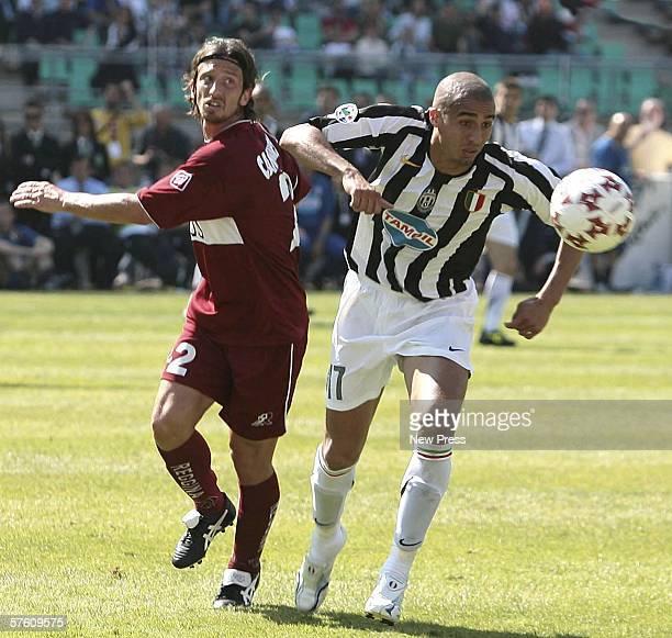 David Trezeguet of Juventus battles with Juriy Cannarsa of Reggina during the Serie A match between Reggina and Juventus at the Stadio Granillo on...