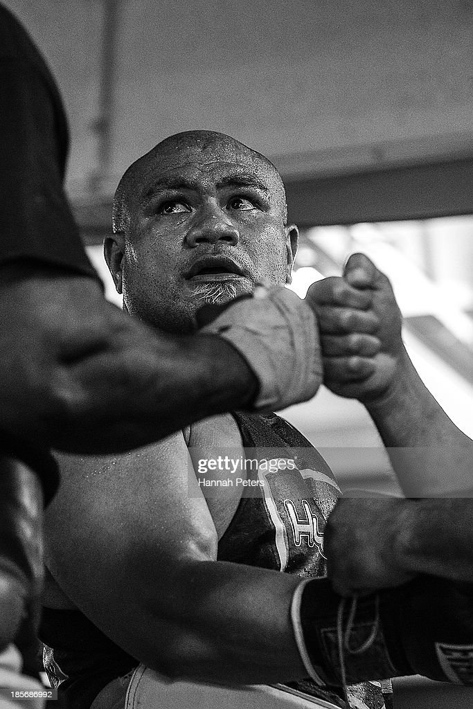 <a gi-track='captionPersonalityLinkClicked' href=/galleries/search?phrase=David+Tua&family=editorial&specificpeople=220232 ng-click='$event.stopPropagation()'>David Tua</a> has his gloves removed following sparring session at the <a gi-track='captionPersonalityLinkClicked' href=/galleries/search?phrase=David+Tua&family=editorial&specificpeople=220232 ng-click='$event.stopPropagation()'>David Tua</a> Gym on October 24, 2013 in Auckland, New Zealand. Tua is training ahead of the David v Goliath boxing match with Alexander Ustinov.