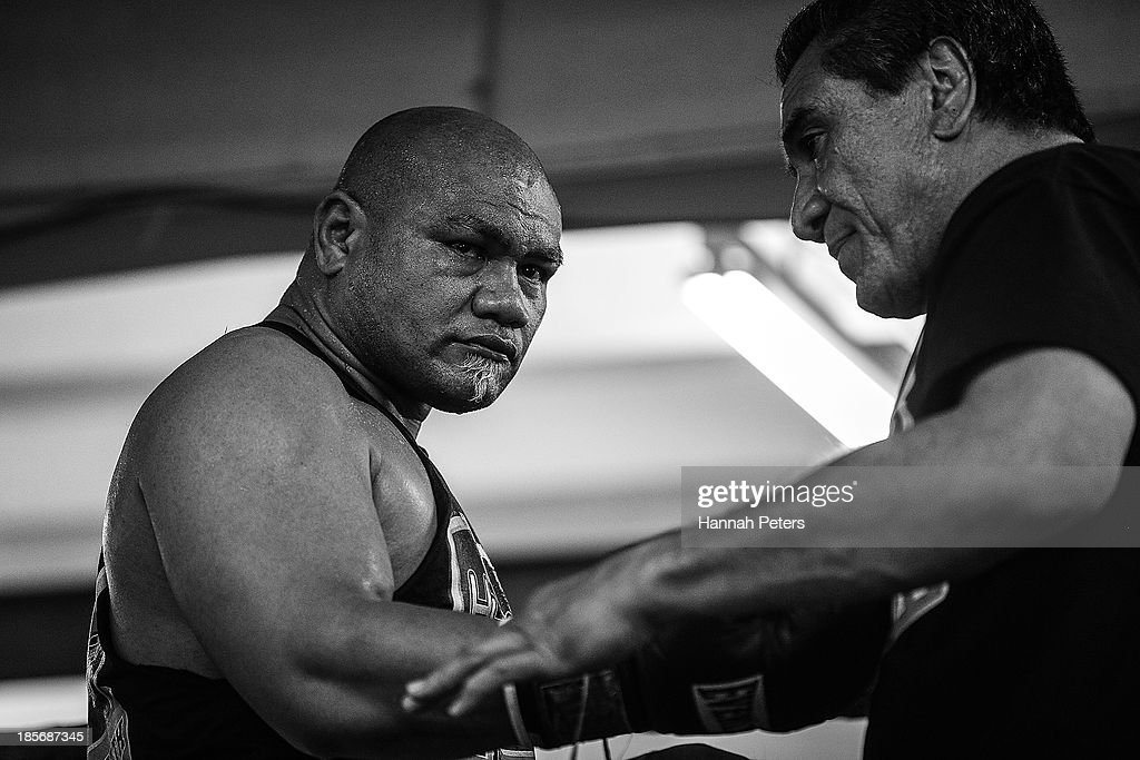 David Tua has his gloves removed following sparring session at the David Tua Gym on October 24, 2013 in Auckland, New Zealand. Tua is training ahead of the David v Goliath boxing match with Alexander Ustinov.