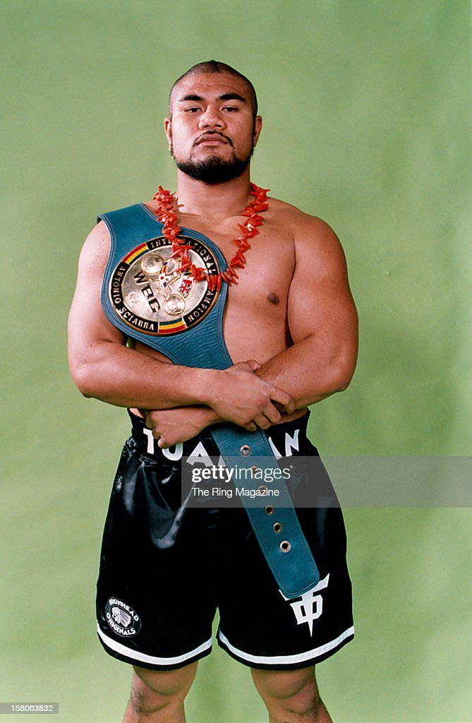 <a gi-track='captionPersonalityLinkClicked' href=/galleries/search?phrase=David+Tua&family=editorial&specificpeople=220232 ng-click='$event.stopPropagation()'>David Tua</a> poses for a portrait with his belt, on April 4,1997.
