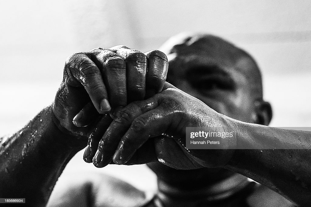 <a gi-track='captionPersonalityLinkClicked' href=/galleries/search?phrase=David+Tua&family=editorial&specificpeople=220232 ng-click='$event.stopPropagation()'>David Tua</a> takes a break following a sparring session at the <a gi-track='captionPersonalityLinkClicked' href=/galleries/search?phrase=David+Tua&family=editorial&specificpeople=220232 ng-click='$event.stopPropagation()'>David Tua</a> Gym on October 24, 2013 in Auckland, New Zealand. Tua is training ahead of the David v Goliath boxing match with Alexander Ustinov.