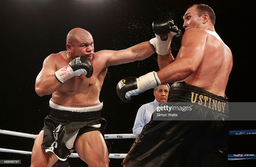 <a gi-track='captionPersonalityLinkClicked' href=/galleries/search?phrase=David+Tua&family=editorial&specificpeople=220232 ng-click='$event.stopPropagation()'>David Tua</a> throws a punch to the face of Alexander Ustinov during the bout between <a gi-track='captionPersonalityLinkClicked' href=/galleries/search?phrase=David+Tua&family=editorial&specificpeople=220232 ng-click='$event.stopPropagation()'>David Tua</a> and Alexander Ustinov at Claudelands Arena on November 16, 2013 in Hamilton, New Zealand.