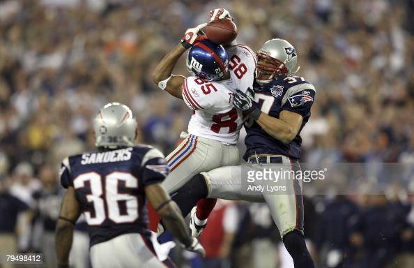 David Tyree of the New York Giants catches a 32yard pass from Eli Manning against Rodney Harrison and James Sanders of the New England Patriots...