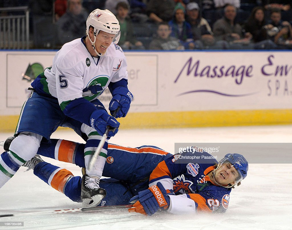 David Ullstrom #24 of the Bridgeport Sound Tigers falls to the ice after being checked by Blake Parlett #5 of the Connecticut Whale during an American Hockey League game on December 26, 2012 at the Webster Bank Arena at Harbor Yard in Bridgeport, Connecticut.