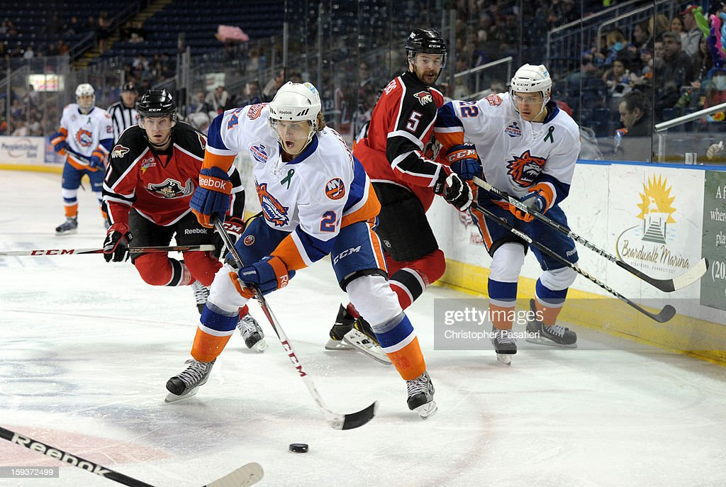 David Ullstrom #24 of the Bridgeport Sound Tigers skates with the puck during an American Hockey League game against the Portland Pirates on January 12, 2013 at the Webster Bank Arena at Harbor Yard in Bridgeport, Connecticut.