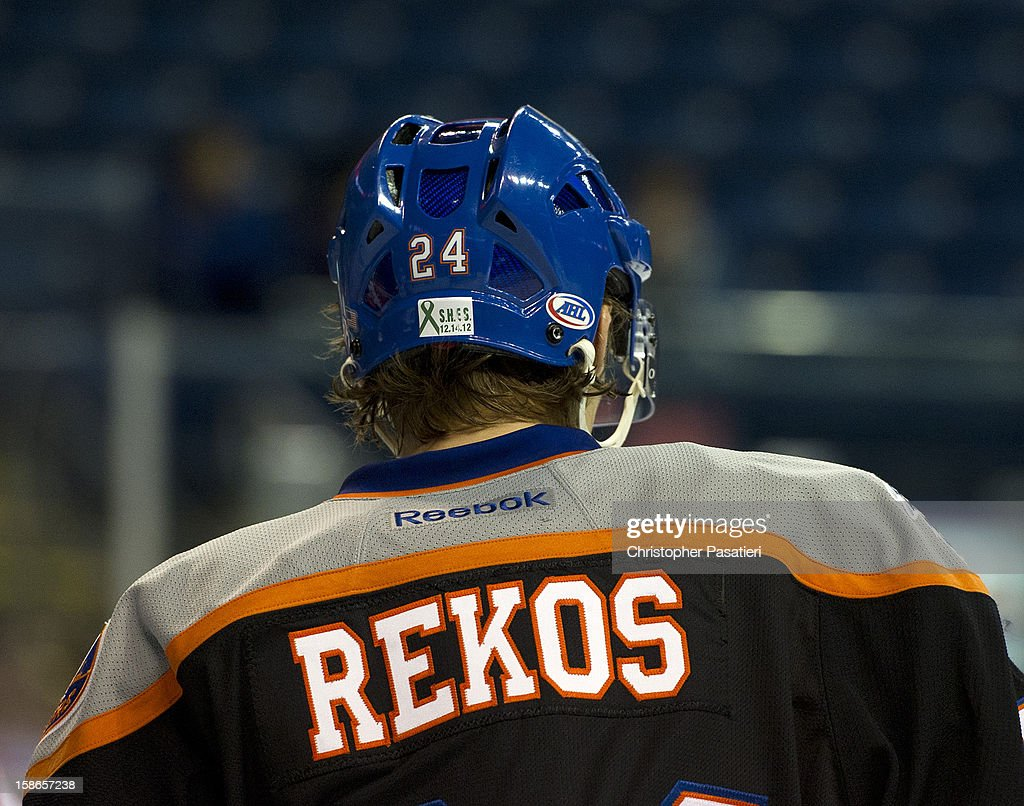David Ullstrom #24 of the Bridgeport Sound Tigers wears the name of Sandy Hook Elementary School shooting victim Jessica Rekos on the back of his jersey as part of a tribute during an American Hockey League game against the Adirondack Phantoms on December 22, 2012 at the Webster Bank Arena at Harbor Yard in Bridgeport, Connecticut.