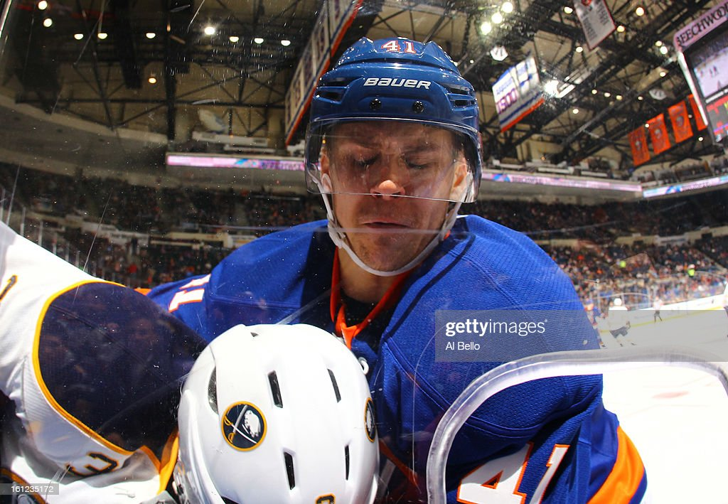 David Ullstrom #41 of the New York Islanders checks Jordan Leopold #3 of the Buffalo Sabres during their game at Nassau Veterans Memorial Coliseum on February 9, 2013 in Uniondale, New York.