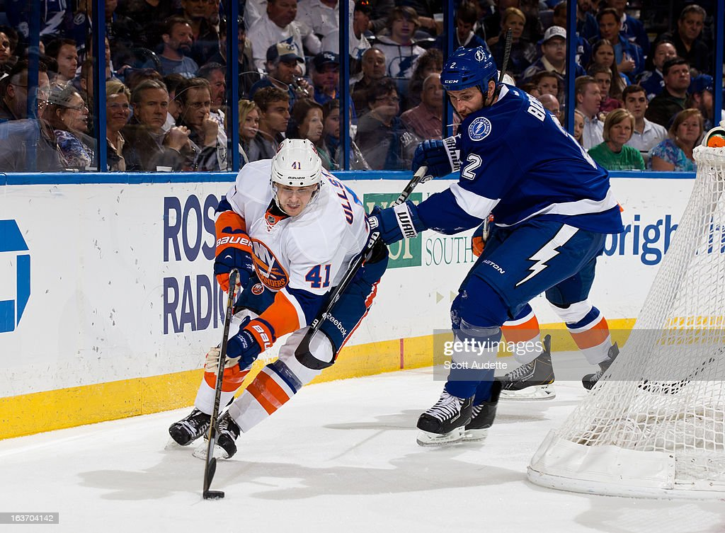 David Ullstrom #41 of the New York Islanders moves the puck around the net while <a gi-track='captionPersonalityLinkClicked' href=/galleries/search?phrase=Eric+Brewer&family=editorial&specificpeople=202144 ng-click='$event.stopPropagation()'>Eric Brewer</a> #2 of the Tampa Bay Lightning defends during the second period of the game at the Tampa Bay Times Forum on March 14, 2013 in Tampa, Florida.