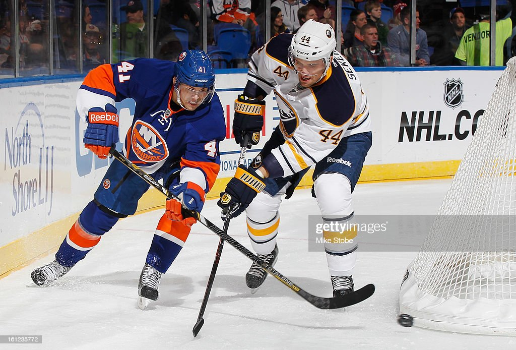 David Ullstrom #41 of the New York Islanders pursues the puck against Andrej Sekera #44 of the Buffalo Sabres at Nassau Veterans Memorial Coliseum on Febuary 9, 2013 in Uniondale, New York.