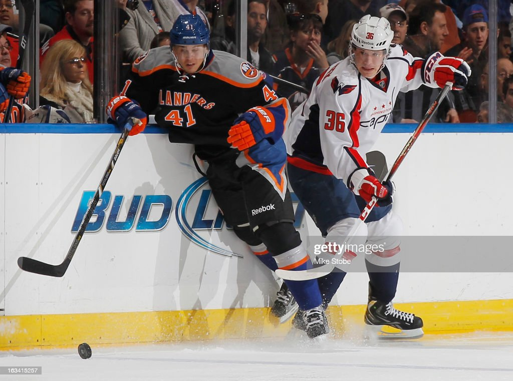David Ullstrom #41 of the New York Islanders pursues the puck against Tomas Kundratek #36 of the Washington Capitals at Nassau Veterans Memorial Coliseum on March 9, 2013 in Uniondale, New York.
