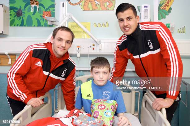 David Vaughan and Karl Darlow pose with a patient in the Children's Ward